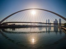 Panorama of the city early in the morning at dawn with a bridge over the city channel Dubai Greek. royalty free stock photos