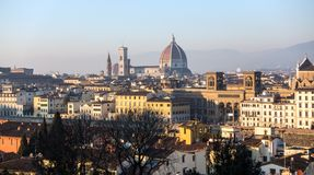 AERIAL. Panorama of the city of FLORENCE in Italy with the dome and Palazzo della Signoria and arno river royalty free stock photo