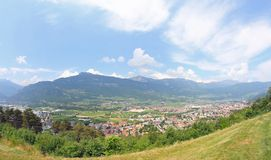 Panorama of the city with the houses and the mountains in the ba Royalty Free Stock Photos