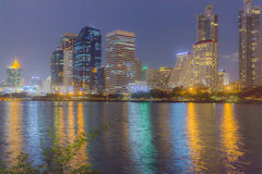 Panorama city at night, Bangkok. The background of the lotus leaves bright green royalty free stock photo