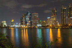 Panorama city at night, Bangkok. The background of the lotus leaves bright green stock photography