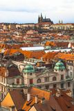 Panorama of the old part of the city of Prague. Panorama of the city of Prague. The old part of the city. Beautiful roofs of shingles. Ancient buildings and stock photo