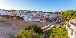 Panorama of the city with restaurants of Carvoeiro. with tourists. Stock Photo