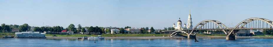 Panorama of the city of Rybinsk with the river station, Transfiguration Cathedral and the automobile bridge. royalty free stock photography