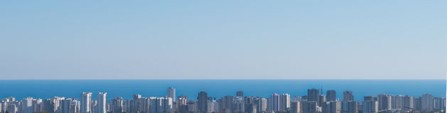 Panorama city and sea scenery from long distance.  panorama Royalty Free Stock Images