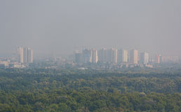 Panorama of the city are shrouded in thick smoke from burning peat bogs. Kiev Stock Images