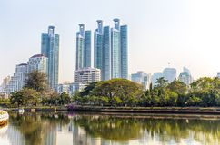 Panorama of cityscape with skyscrapers and skyline from Benjakitti Park in Bangkok, Thailand. stock photos