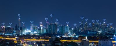 Panorama cityscape with wifi network connection concept. At night stock images