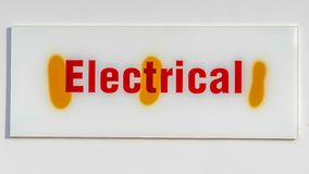 Panorama Close up of an electrical sign board against a white wall royalty free stock photo