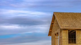Panorama Close up of the exterior of an unfinished house at a construction site royalty free stock photography