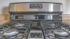 Panorama Close up of a gas stove with a shiny surface inside the kitchen of a house royalty free stock image