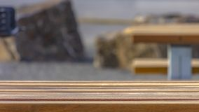 Panorama Close up of a light brown wooden table with benches at a park royalty free stock photo