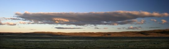 Panorama of clouds over ranchlands, Montana. Panoramic photograph of clouds forming over the plains of Big Sky Country, Montana Royalty Free Stock Photos
