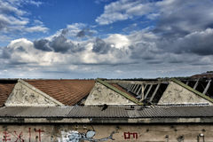 Panorama with clouds swollen from the roof. Scene with white puffy clouds from the window of a building inside Royalty Free Stock Photo