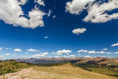 Panorama and cloudscape from Shrine Mountain ridge, Colorado Rockies. The top of the Rockies from the Shrine Mountain ridge near Vail in Colorado leaving room stock photos