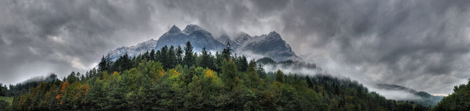 Panorama of Cloudy Mountains and a Forest royalty free stock photo