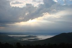 Panorama of the cloudy sky above the Borzhava ridge. The still nature of the Ukrainian Carpathians under the thunderous clouds of an impending storm Royalty Free Stock Images