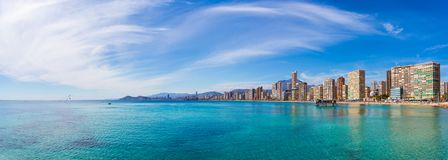Panorama of the coast city with sea and sky. Panorama of the coast of the city with beautiful sky with clouds and clear blue water on the background of urban Royalty Free Stock Images