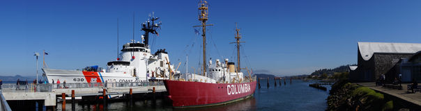 Panorama,  Coast Guard Cutter  and Lightship. ASTORIA, OREGON - OCT 1, 2015 - Coast Guard Cutter Alert, 630,  and Lightship Columbia, anchored at the   Columbia Royalty Free Stock Photos