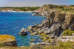 Panorama of the coast near Carloforte Island of San Pietro, Car. Glimpse of the cliff near Carloforte Island of San Pietro, Carbonia-Iglesias, Sardinia, Italy in Royalty Free Stock Image