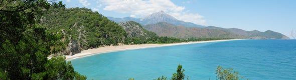 Panorama of coast olympos turkey. Panorama of olympos coast view of beach and mountains turkey Stock Photos