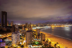 Panorama of the coastal city at sunset with lights reflected in sea. Panorama of the coastal city at evening with lights reflected in sea. Spain, Benidorm Royalty Free Stock Photo