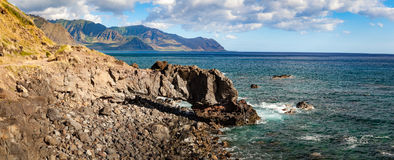 Kaena Point Landscape Panorama. Panorama coastal landscape and seascape of Kaena Point National Park on Oahu, Hawaii north shore with rocky arch royalty free stock photography
