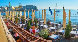 Panorama of the coastal restaurant in St Julian`s, Malta royalty free stock photo