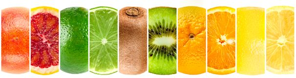 Panorama collection of whole and cut tropical fruits royalty free stock photos