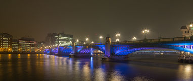 Blackfriars bridge. Panorama of colorful blackfriars bridge over the river Thames at dusk, beautifuuly lit in blue and purple In London, capital lof United Royalty Free Stock Image