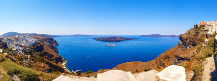 Panorama of colorful houses in Fira town, and view on caldera Santorini island Royalty Free Stock Image