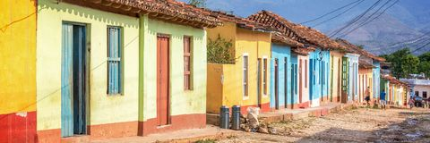 Panorama of colorful houses in a paved street of Trinidad Cuba Stock Images