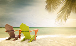 Panorama of colorful lounge chairs at a tropical paradise beach in Miami Florida. Desaturated vintage instagram filter for retro looks Royalty Free Stock Images