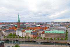 Panorama of colorful roof tops and old churches in Copenhagen, Denmark. Royalty Free Stock Photography