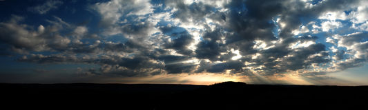 Panorama of a colorful sunset. Panorama of a colorful cloudy sunset Stock Photography