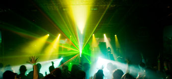 Panorama of a concert in green light. Panorama of a concert, laser show with green lights Stock Image