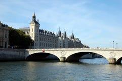 Conciergerie and  bridge Pont au Change in Paris. Panorama of Conciergerie and  bridge Pont au Change in Paris, France stock image