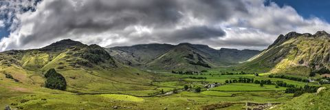 Panorama Coniston, Lake District. Panoramic view of the majestic mountain landscape near Coniston in the English Lake District under a dramatic sky Royalty Free Stock Photography