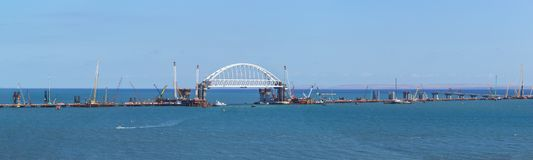 Panorama of construction of road and rail bridges across the Kerch Strait. The arched span of the railway bridge over the navigabl Royalty Free Stock Images