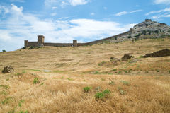 Panorama of the Consular castle in the medieval Genoese fortress on a Sunny June day. Sudak, Crimea Stock Photos