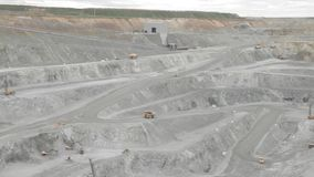 Panorama of the copper open pit trucks and rigs. Panorama of the copper open pit: trucks and rigs stock video footage