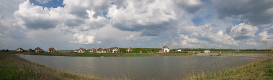 Panorama of cottage town on the lake shore Stock Photo