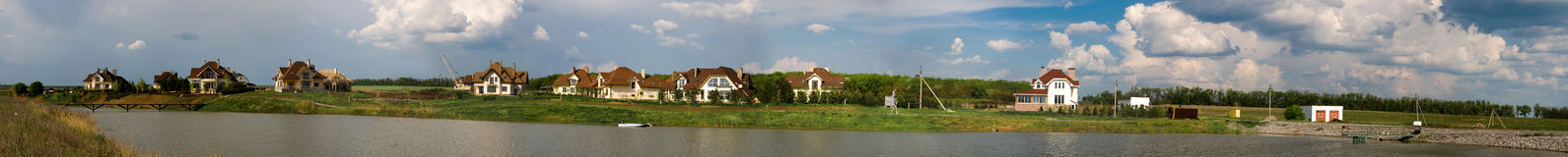 Panorama of cottage town on the lake shore Royalty Free Stock Photography