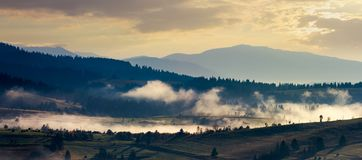 Panorama of countryside in the morning fog. Panorama of countryside in the morning. beautiful landscape in mountains with fog rising above the valley and hill royalty free stock photography