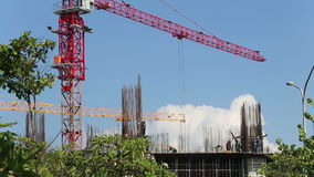 Panorama of crane above steel frame of skyscraper stock video footage