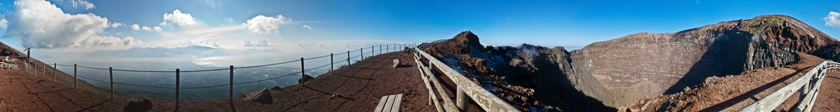 Panorama at crater of volcano Vesuvio. Seen crater inside and bay of Naples Royalty Free Stock Photos