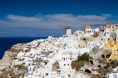 Panorama of cyladic village of Oia Royalty Free Stock Images