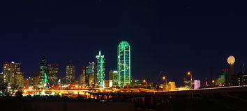 Panorama of the Dallas skyline at night. A Panorama of the Dallas, Texas skyline at night royalty free stock photo