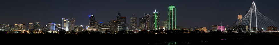 Panorama of Dallas, Texas Skyline on a clear night with full moon Stock Photos