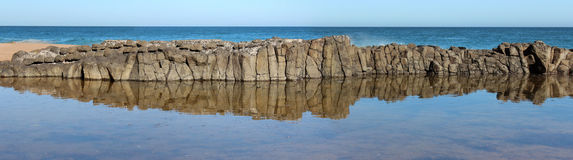 Panorama of  dark  basalt rocks at Ocean beach Bunbury  Western Australia Royalty Free Stock Image